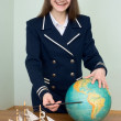 Stock Photo: Womin seuniform with globe