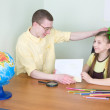Stock Photo: Girl shows new drawing to brother