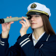 Portrait of woman captain with telescope — Stock Photo