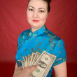 Japanese girl and dollars — Stock Photo