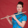 Japanese girl with flute - Stock Photo