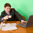 Businessman on a workplace with laptop — Stock Photo