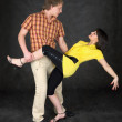 Couple dancing a tango on a black — Stock Photo #2277923