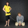 Guy chained in a chain and girl — Foto de Stock
