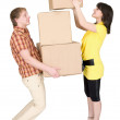 Girl loads the man with cardboard boxes - Foto Stock