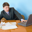 Businessman on a workplace with the laptop — Stock Photo