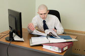 Bookkeeper on a workplace at office — Foto Stock