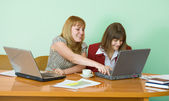 Girls work sitting at a table — Foto Stock