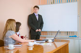 Young man to speak at a meeting — Stock Photo