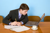 Businessman on a workplace — Stock Photo