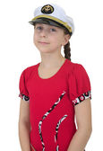 Young girl in uniform cap — Stock Photo
