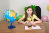 Girl sitting at a table with plasticine — Stok fotoğraf