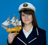 Woman with uniform cap and the ship — Stock Photo