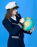 Woman in sea uniform and globe — Stock Photo