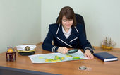 Woman in uniform with geographic map — Stock Photo