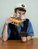 Man in uniform cap with sailer — Stock Photo