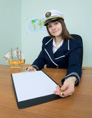 Girl in a sea uniform with tablet — Stock Photo