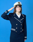 Girl in a sea uniform salutes — Stock Photo