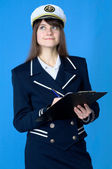 Girl in sea uniform with tablet — Stock Photo