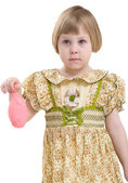 Little girl with blowing off balloon — Stock Photo