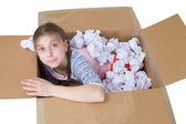 Girl in cardboard box — Stock Photo