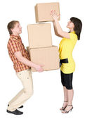 Girl loads the man with cardboard boxes — Stock Photo