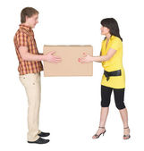 Guy and the girl divide big box — Stock Photo