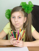 Girl with color pencils in hands — Stock Photo