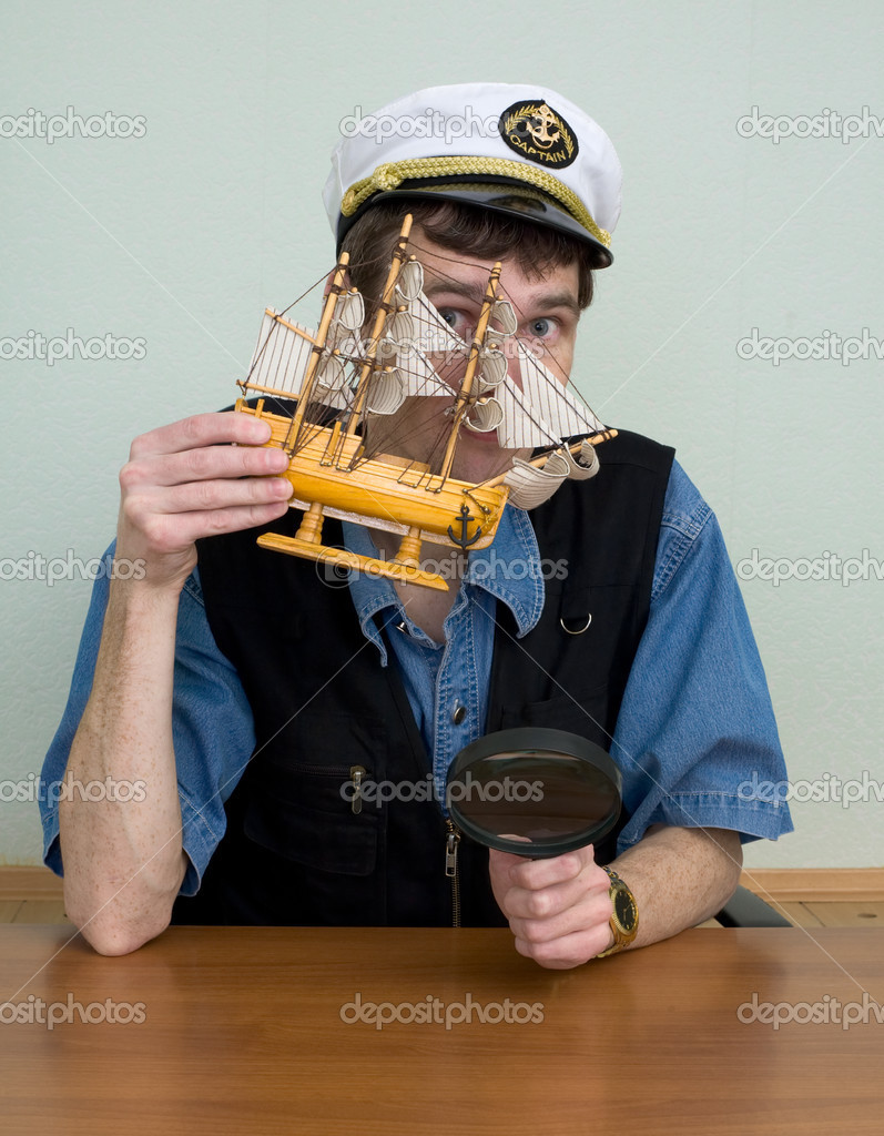 Man in uniform cap at a table with sailer  Stock Photo #2273529
