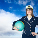 Girl in sea uniform and globe — Stock Photo