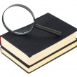Two black books and magnifier glass — Stock Photo