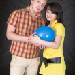 Royalty-Free Stock Photo: Pair holds on hands a ballon as the baby