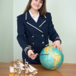 Girl in a sea uniform with globe — Stock Photo