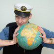 Stock Photo: Guy in seuniform cap with globe