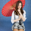 Beautiful girl with the Chinese umbrella — Stock Photo