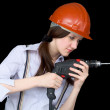 Girl in a protective helmet with a drill — Stock Photo #2284153