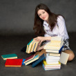 Stock Photo: Schoolgirl with the big heap of books
