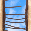 Old window closed by rusty lattice — Stock Photo