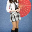 Girl with red umbrella on a blue background — Stock Photo