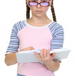 Serious schoolgirl with spectacles, book — Stock Photo