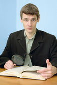 Man read book on a workplace — Stock Photo