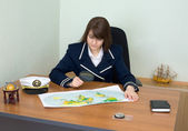 Woman - captain at a table — Stock Photo