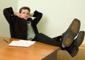 Boss in black suit on a workplace — Stock Photo