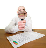 Guy looks through the big magnifier — Stock Photo