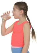 Girl drinks water from a glass — Stock Photo