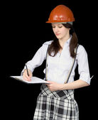 Young woman in a helmet with a tablet — Stock Photo