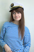 Girl in stripped vest and a uniform cap — Stock Photo