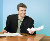 Director on a workplace with a crushed paper — Stock Photo