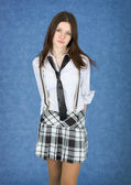 Girl in a skirt on a blue background — Stock Photo