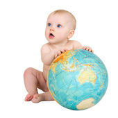 Baby and terrestrial globe — Photo
